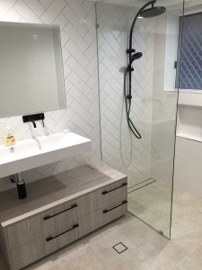 Stunning bathroom renovation with discrete tile insert